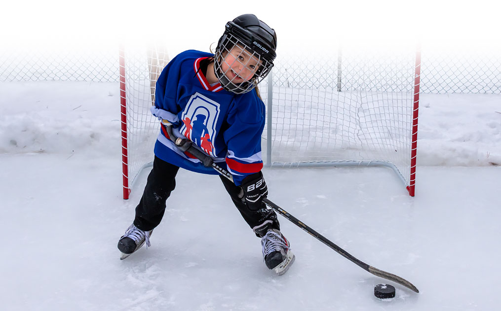 Champ Audrey, using her specialized artificial arm to play hockey. Links to a page that highlights her story.