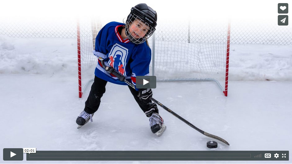 Audrey, using her specialized artificial arm to play hockey. Watch video featuring child amputees Audrey and Leah.